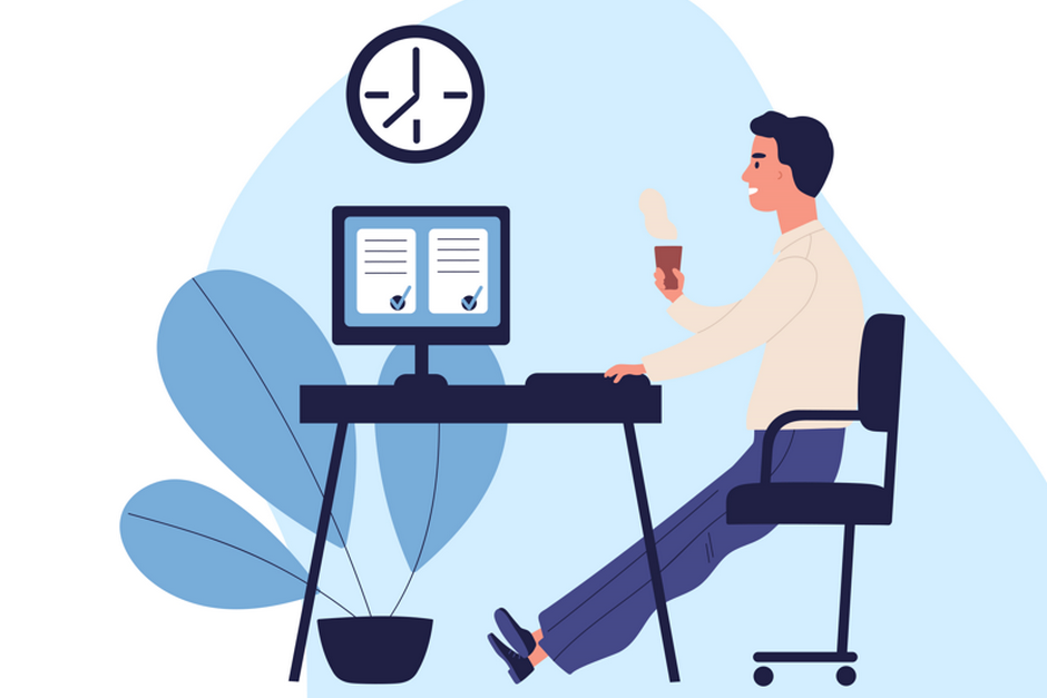 Man working at computer with coffee in his hand