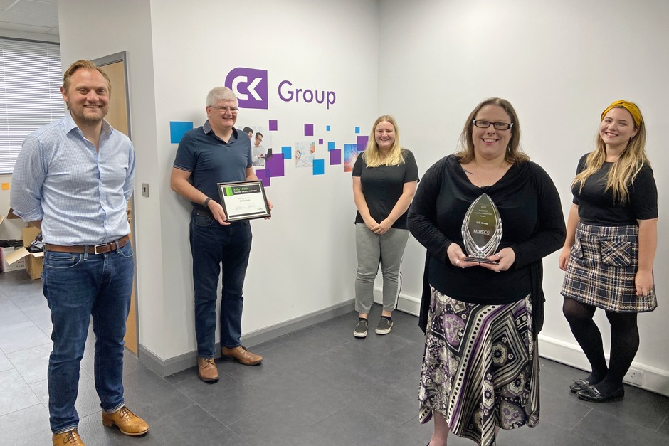 CK Group team members holding KellyOCG Supplier Excellence Award